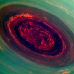 In an undated in this false-color image from NASA's Cassini spacecraft and provided by NASA/JPL shows stunning views of a monster hurricane at Saturn's North Pole.