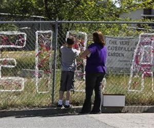 Teacher Cecilia Richardson helps a student tie a ribbon honoring murder victim, third grader Leila Fowler, at Jenny Lind Elementary School in Valley Springs, Calif., Monday April 29, 2013.