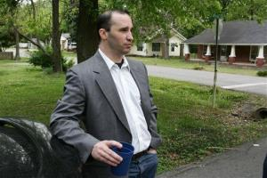 In this April 23 photo, Everett Dutschke stands in the street near his home in Tupelo, Miss., and waits for the FBI to arrive and search his home.