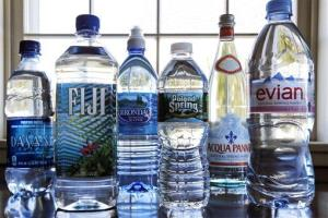 In this Tuesday, March 5, 2013 photo, a selection of bottled waters stands on a kitchen counter in East Derry, NH.