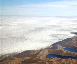 Glaciers and icebergs of the Greenland ice cap are seen over Greenland.