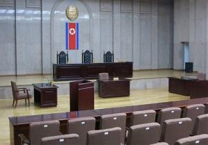 In this March 20, 2013 photo, a North Korean flag hangs inside the interior of Pyongyang's Supreme Court.