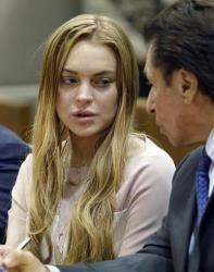 Actress Lindsay Lohan and attorney Mark Heller appear at a hearing in Los Angeles Superior Court Monday, March 18, 2013.