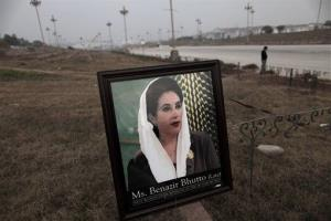A framed photograph of Pakistan's slain leader Benazir Bhutto, is left by supporters at the site of a ceremony to mark the fifth anniversary of her death, in Islamabad, Pakistan, Dec. 27, 2012.