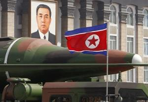 In this file photo taken Sunday, April 15, 2012, what appears to be a new missile is carried during a mass military parade at the Kim Il Sung Square in Pyongyang, North Korea.