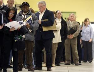In this Thursday, April 11, 2013 photo, people wait in line before the Dr. King Career Fair at the Empire State Plaza Convention Center in Albany, NY.