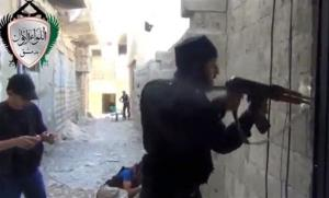 In this image taken from video obtained from the Ugarit News, Syrian rebels clash with government forces in Damascus Friday.