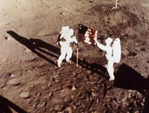 In this July 20, 1969 file photo, Apollo 11 astronauts Neil Armstrong and Edwin E. Buzz Aldrin, the first men to land on the moon, plant the US flag on the lunar surface.