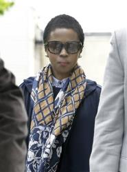 Eight-time Grammy winning singer Lauryn Hill, center, walks to federal court.