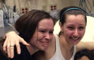 Amanda Berry, right, hugs her sister Beth Serrano after being reunited in a Cleveland hospital Monday May 6, 2013.