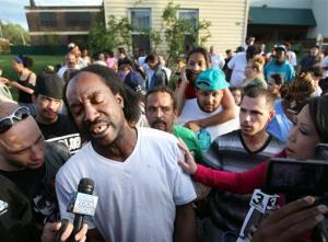 Neighbor Charles Ramsey speaks to media near the home on the 2200 block of Seymour Avenue, where three missing women were rescued in Cleveland, on Monday, May 6, 2013.