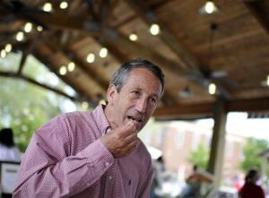 Former South Carolina Gov. Mark Sanford takes a sample of olives at the Mount Pleasant Farmers Market in Mount Pleasant, S.C., Tuesday.