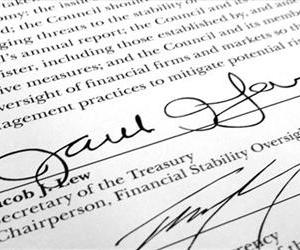 Treasury Secretary Jacob Lew's signature is shown on the annual report for the Financial Stability Oversight Council in Washington, on Tuesday, May 7, 2013.