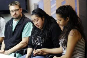 FILE - In this May 2, 2013, file photo, Johana Portillo, center, and her sister Ana Portillo hold hands while Dr. Shawn Smith looks on during a news conference at Intermountain Medical Center, in Murray, Utah. A Utah prosecutor said Monday, May 6, he plans to decide soon what charges...