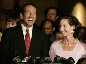 Mark Sanford smiles as he is joined by his wife, Jenny, after he won the Republican gubernatorial nomination in Columbia, South Carolina in 2006.