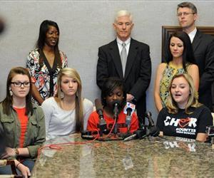 Kountze High School cheerleaders, from left, Savannah Short, Macy Matthews, Kieara Moffett and Rebekah Richardson speak to reporters Wednesday, May 8, 2013, in Beaumont, Texas.