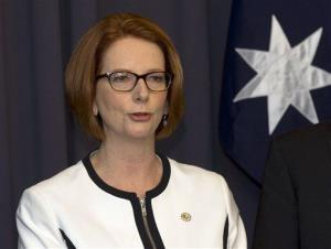 In this March 21, 2013 file photo, Australia's Prime Minister Julia Gillard makes a statement to the media after a leadership ballot in Canberra, Australia.