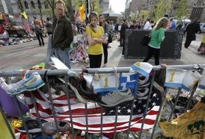 People pause to look at a makeshift memorial near the Boston Marathon finish line in Boston's Copley Square Tuesday, May 7, 2013 in remembrance of the Boston Marathon bombings.