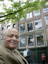 In this June 25, 2007 file photo, Anne Frank's cousin Bernhard Buddy Elias poses for a portrait in front of the Anne Frank House in Amsterdam.