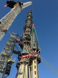 Workers prepare to raise the silver spire atop the 1 World Trade Center building in New York early Friday May 10, 2013. The 408-foot spire will serve as a world-class broadcast antenna. An LED-powered light emanating from it will be seen from miles away. When it is fully installed on...