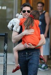 This July 17, 2012, photo shows actor Tom Cruise and daughter Suri leaving Chelsea Piers in New York.