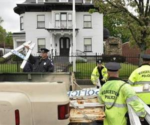 Worcester police remove barricades from in front of the Graham Putnam & Mahoney funeral home in Worcester, Mass.,  on Thursday, May 9, 2013.