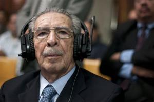 Former Guatemala former dictator Efrain Rios Montt wears headphones as he listens to the verdict in his genocide trial in Guatemala City Friday.