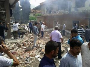 People gather at the site of one of the blasts in Reyhanli, near Turkey's border with Syria, Saturday.