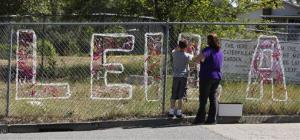 Teacher Cecilia Richardson helps a student tie a ribbon honoring murder victim Leila Fowler at Jenny Lind Elementary School in Valley Springs, Calif.