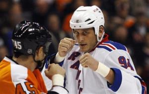 In this Nov. 4, 2010 photo, the Philadelphia Flyers' Jody Shelley, left, and the New York Rangers' Derek Boogaard fight during an NHL hockey game in Philadelphia.