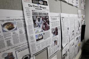 Prototypes of a three-day-a-week New Orleans Times-Picayune are seen taped to a door in a workroom in their news offices in New Orleans, Thursday, Sept. 27, 2012.