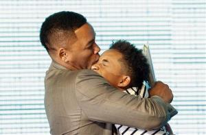 Will Smith kisses his son Jaden during the premiere event of his new film After Earth in Seoul, South Korea, Tuesday, May 7, 2013.