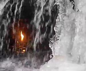 Behind a waterfall sits the eternal flame.