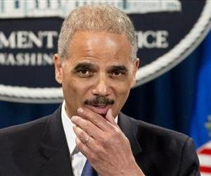 Attorney General Eric Holder is questioned about the Justice Department secretly obtaining telephone records for The Associated Press, during a news conference at the Justice Department, May 14, 2013.