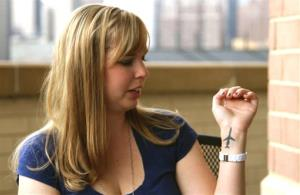 Cecelia Crocker shows an airplane tattoo on her left wrist in a September 2011 photo.