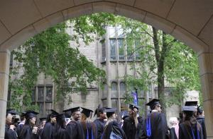 In this 2010 file photo, future graduates wait for the procession to begin for commencement at Yale University in New Haven, Conn.