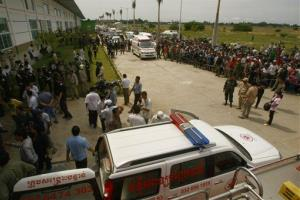 Ambulances wait to transfer injured workers at the site of a factory collapse in Kai Ruong village, south of Phnom Penh, Cambodia.