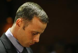 In this Feb. 21 photo, Oscar Pistorius stands during his bail hearing in Pretoria, South Africa.