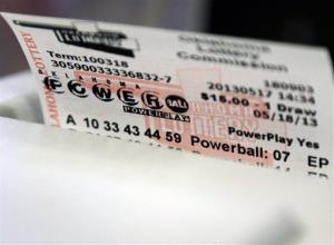 A Powerball ticket is dispensed from a machine in Oklahoma City.