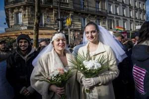 This Jan. 27 file photo shows two women posing during a demonstration in Paris backing gay marriage, which is now legal in the country.