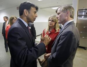 Louisiana Gov. Bobby Jindal, left, talks with Virginia Gov. Bob McDonnell at the Virginia Republican convention in Richmond Friday.