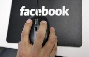 A worker looks at reviews at Facebook headquarters in Menlo Park, Calif.