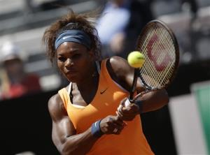 US Serena Williams returns the ball to Belarus' Victoria Azarenka during their final match at the Italian Open tennis tournament in Rome, Sunday, May 19, 2013.