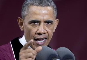 President Barack Obama gestures as he speaks during the Morehouse College 129th Commencement ceremony.