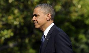 President Barack Obama walks on the South Lawn after returning to the White House in Washington, Sunday, May 19, 2013.