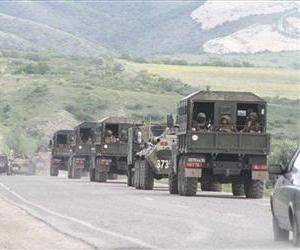 Russian Interior Ministry convoy is parked on a highway at Gubden in the Russian republic of Dagestan, May 9, 2013.