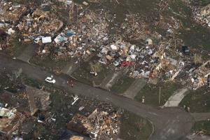 This aerial photo shows the remains of homes hit by a massive tornado in Moore, Oklahoma yesterday.