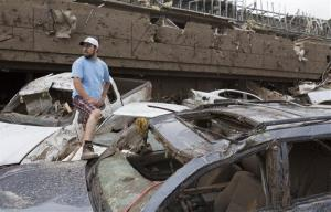 Antonio Flores of Moore, Okla. searches for his car after a tornado damaged the Moore Medical Center and the vehicles in the parking lot in Moore, Okla. on Monday, May 20, 2013.