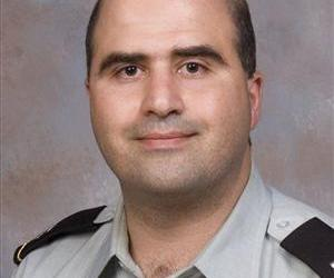 The 2007 file photo provided by the Uniformed Services University of the Health Sciences (USUHS) shows Maj. Nidal Malik Hasan.