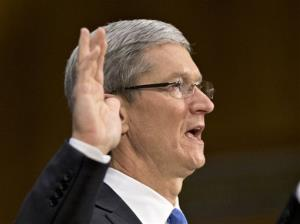 Apple CEO Tim Cook is sworn in on Capitol Hill.